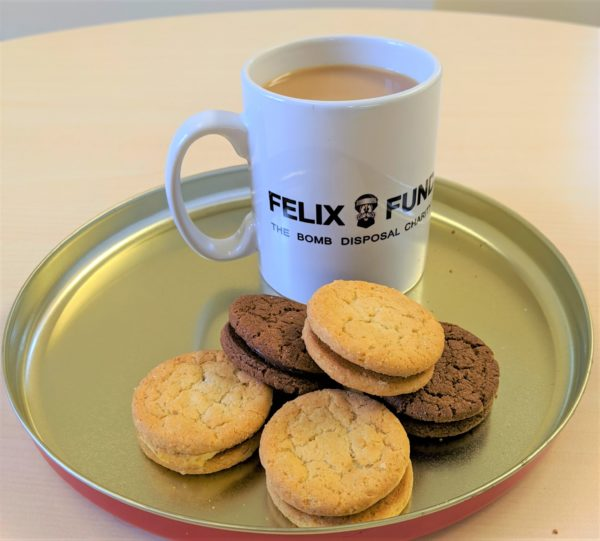 Felix Fund mug of coffee and biscuits